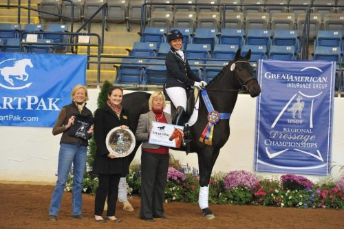 Lisa successfully showed her horse, Qrown Prince, at Regional and National Dressage Championships.